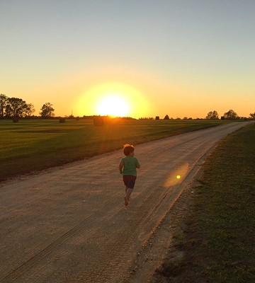 kids running in rural alabama farm land