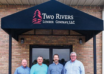 Randell Robinson, Dennis Drinkard, Jay McElroy and Roy Geiger in front of Two Rivers building